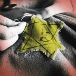old photograph of sewing on a Jewish star