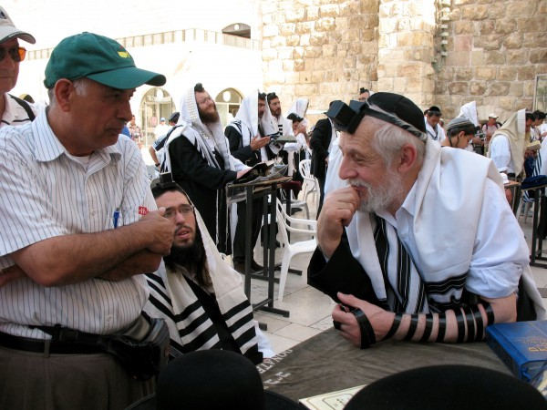 A Palestinian Christian and a Jewish Orthodox man have a discussion at the Western (Wailing) Wall in Jerusalem.
