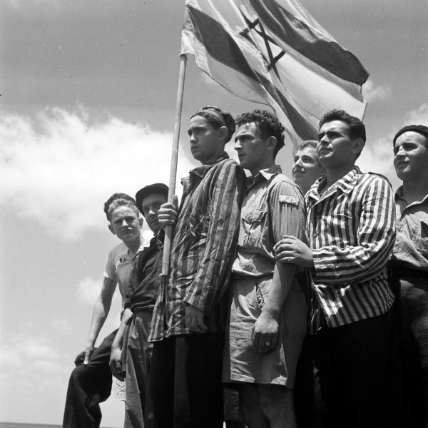 A group of former Buchenwald concentration camp inmates on board the refugee ship Mataroa in Haifa Port (July 7, 1945).  (GPO photo by Kluger Zoltan)