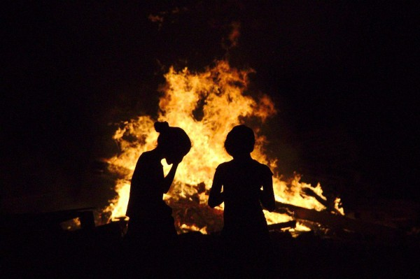 Israeli girls admire the traditional Lag BaOmer bonfire. (Photo by Ari B.)