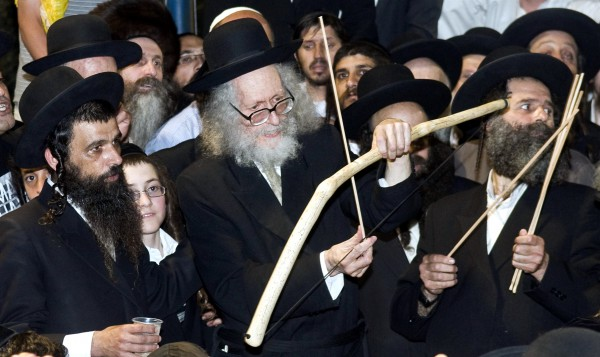 Rabbi Eliezer Berland shoots arrows with a bow near Bar Yochai's tomb in Meron, Israel during Lag BaOmer. Archery is a Lag BaOmer custom that, to some, represents Bar Yochai's words which were shot like arrows, bringing repentance to the unholy.
