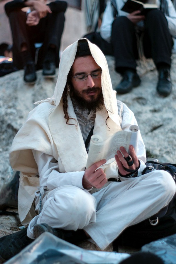 A Jewish man in Meron rises early to pray Shacharit (morning prayer) on Lag BaOmer.
