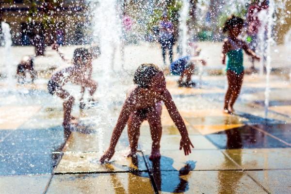 Children play in a Tel Aviv fountain.
