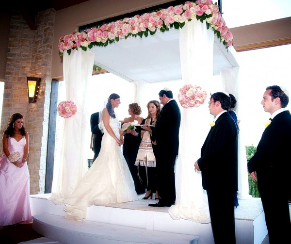 A Jewish wedding is conducted under the chuppah, which symbolizes the home the couple will build together.