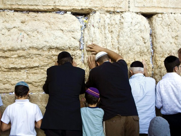 Jewish men and children pray at the Western (Wailing) Wall in Jerusalem.