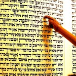 Torah scroll and a wooden yad (Torah pointer)