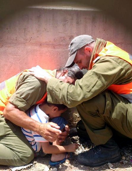 IDF officers shield a 4-year-old boy, protecting him with their own bodies during a Hamas rocket attack