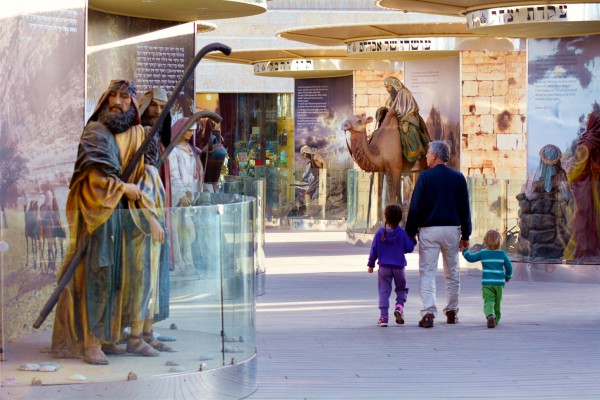 A father brings his children through the Bible City exhibits at Cinema City in Jerusalem. Within this particular set of exhibits are 62 stories from the Bible, including the creation of the world, the binding of Isaac, Jacob's ladder, and the biggest Noah's Ark exhibit of its kind in the world.