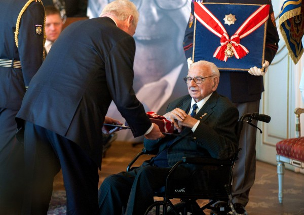 Sir Nicholas Winton (right) receives the Order of the White Lion from Czech President Miloš Zeman (left) at Prague Castle in Prague, Republic, on October 28, 2014.
