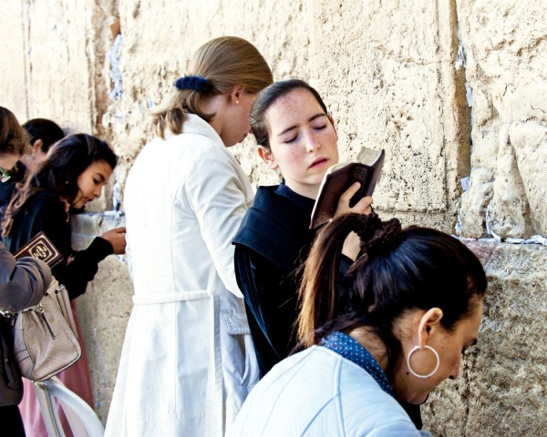 A Jewish woman sways back and forth as she prays at the Western (Wailing) Wall in Jerusalem.
