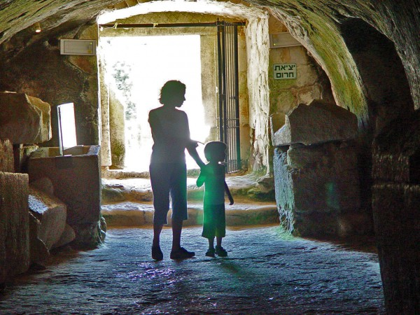 A mother and child visit the Cave of Coffins at Beit She'arim.