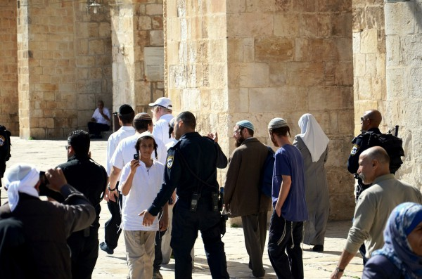 Police escort a small group of Jewish visitors on the Temple Mount.  (Photo by Michael Jones)