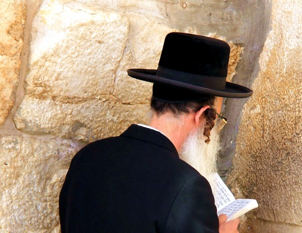 An ultra-Orthodox Jewish man with payot (sidecurls) prays at the Western (Wailing) Wall.