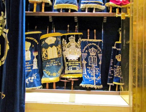 Torah scrolls are housed in a synagogue's Aron Kodesh (Torah ark).