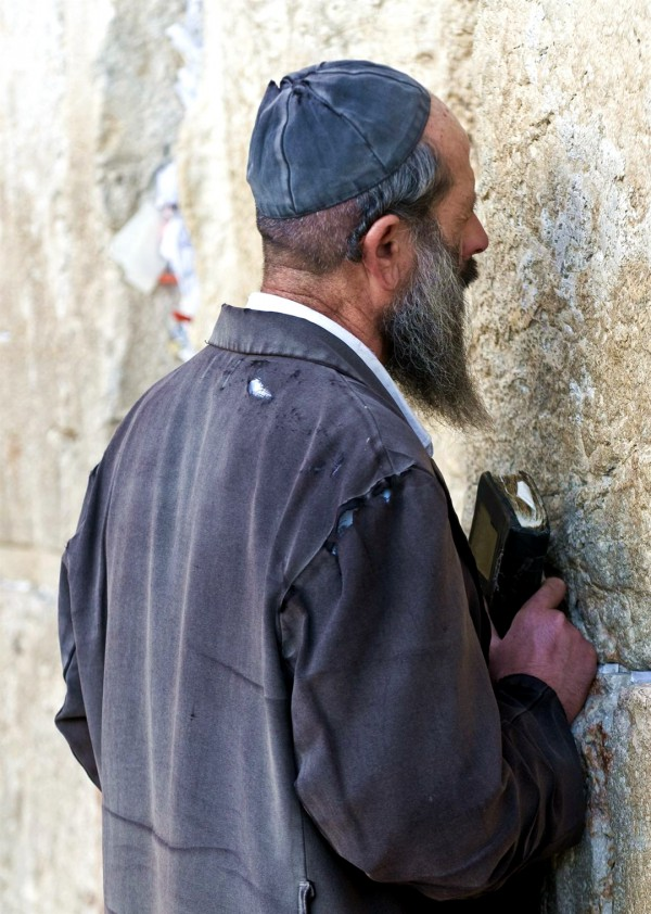 An impoverished Jewish man prays at the Western (Wailing) Wall.