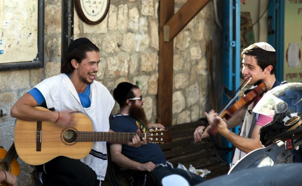 Pre- Shabbat celebration on a street in Tzfat (Safed), a spiritual and artistic center in Israel.