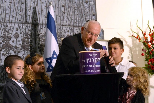 President Reuven Rivlin, together with Israeli children, lights a memorial candle for Yitzhak Rabin.