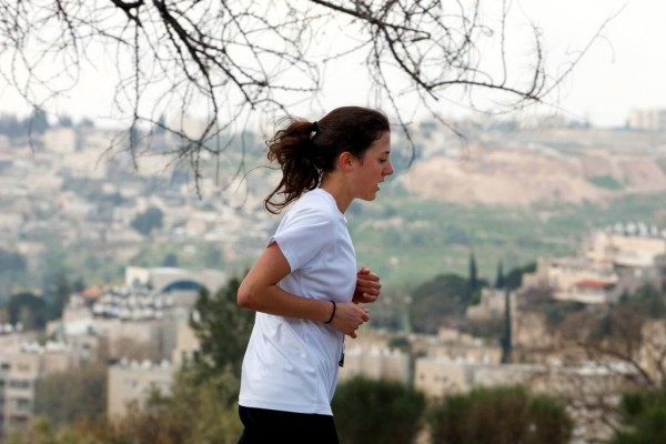 A woman runs in the Jerusalem Marathon