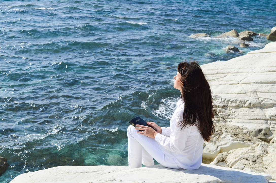 http://www.dreamstime.com/royalty-free-stock-photography-beautiful-girl-alone-beach-sitting-praying-to-god-image36920527