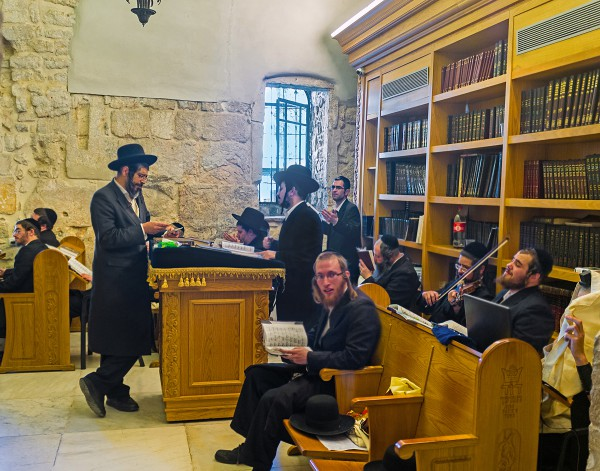 Orthodox worshipers pray, sing, play the violin, and dance in the synagogue at King David's Tomb.