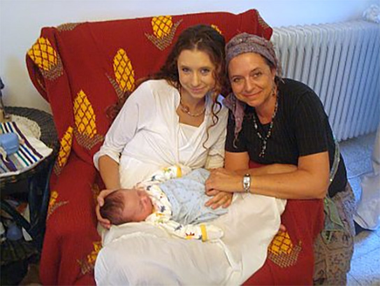 Proud Jewish grandmother with her daughter and her eight day old grandson at his brit milah.