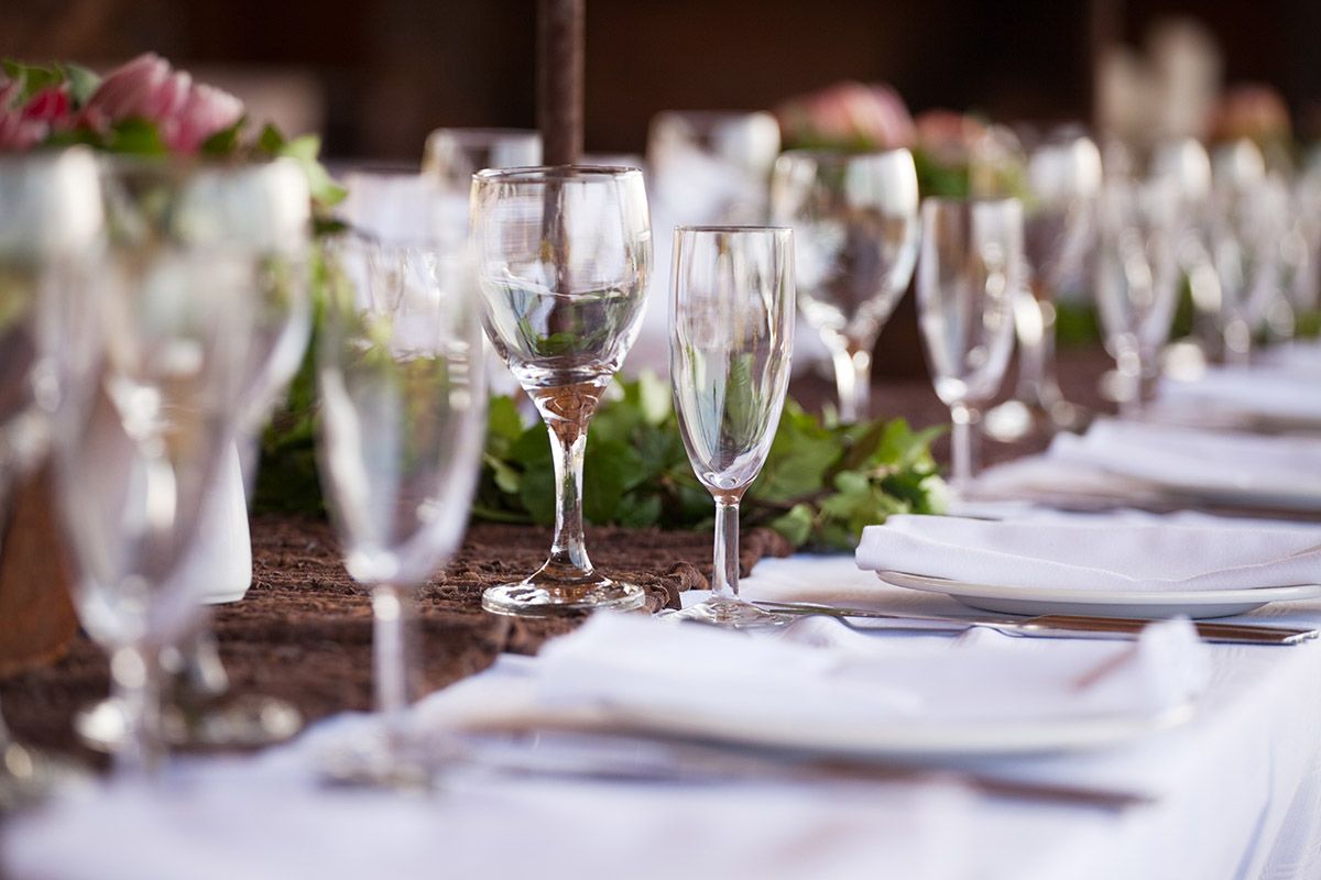 wine glasses on banquet table