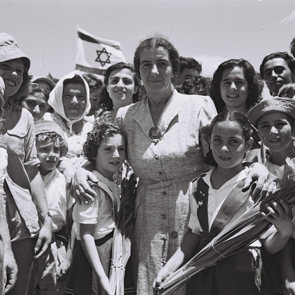 Golda Meir, who became Israel's only female prime minister to date, was Secretary of the women's HeChalutz chapter in the USA from 1932–1934. In this 1950 photo, she is standing with children from Kibbut Shefayim, which was founded in 1935 by Polish immigrants in central Israel.