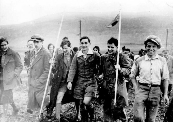 Youth making Aliyah from Germany, marching toward Kibbutz Ein Harod in the Jezreel Valley of northern Israel on February 16, 1934.
