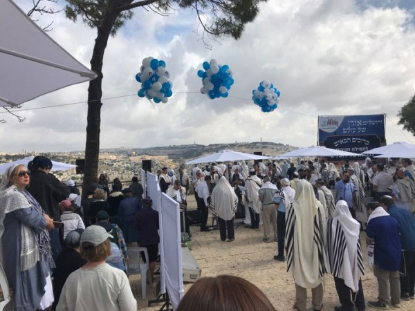 On Jerusalem Day, May 13, 2018, Rabbis, singers, and dancers (Jewish and Gentile) gathered on the Jerusalem promenade overlooking the Temple Mount and the Mount of Olives to sing the Hallel psalms, acknowledging the God of Israel and all that He has done in restoring His Land and People.