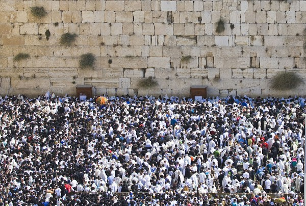 Jewish People gather for prayer at the Western (Wailing) Wall in Jerusalem.