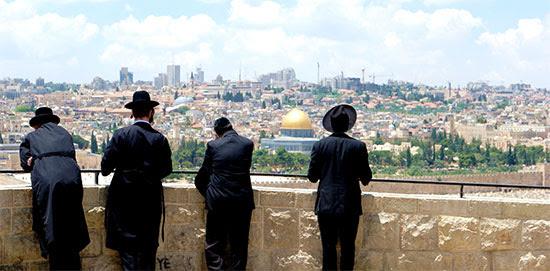 Orthodox Jewish men overlook Jerusalem