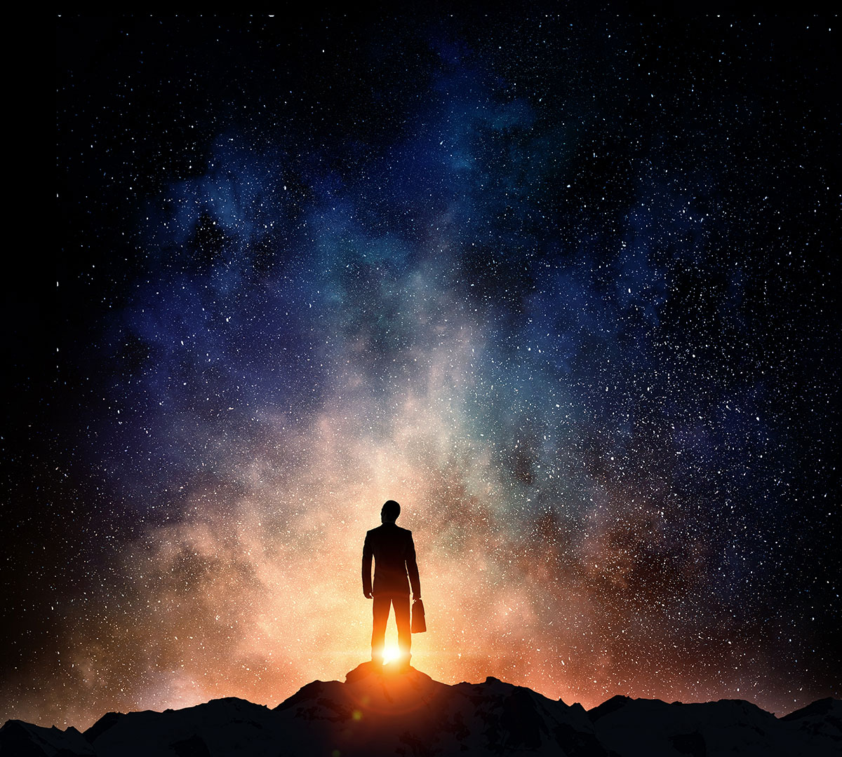 silhouette of man looking up into space