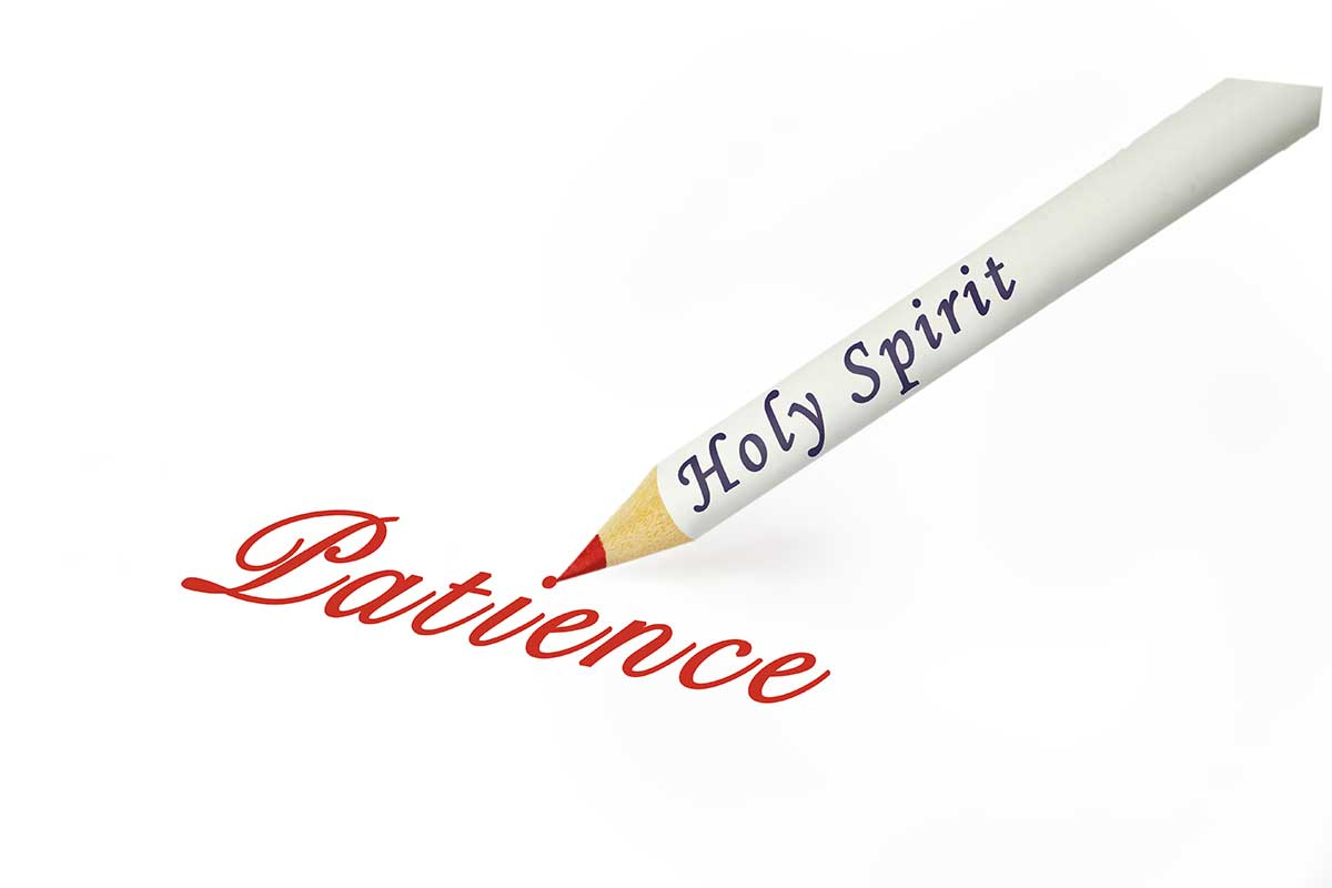 "The words ""Holy Spirit"" is written on a pencil and the pencil has written the word ""Patience on a paper."